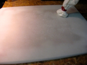 Parchment paper and cornstarch puff.