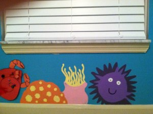 Coral, anemone, and sea urchin, plus a cute crab her son made for the nursery.